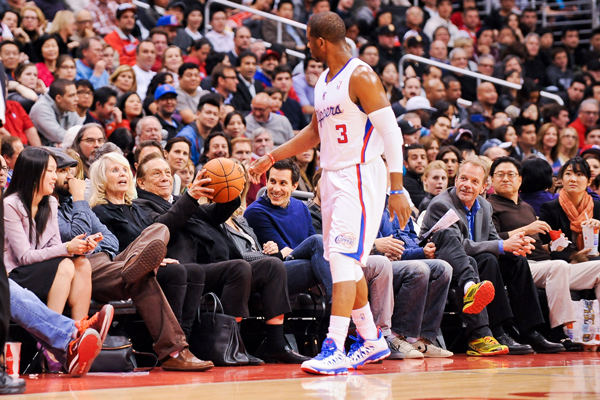 Chris Paul (center) has spent two seasons playing for Clippers owner Donald Sterling. (Noah Graham/Getty Images)
