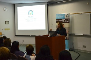 Edith Lara-Trad, information officer at Covered California, welcomes representatives from Inland community groups to the first Covered California regional meeting at Loma Linda University Health.