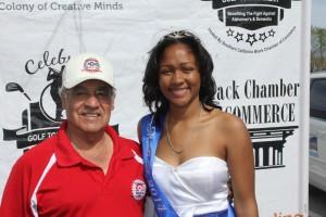 "Former Congressman, Joe Baca, congratulates Terris Williams, ""2014 Fontana, Ms Black Awareness"". (Photo Credit: John Coleman)"
