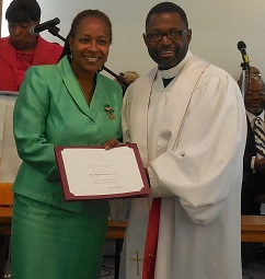 President, Annette Wealthington graciously receives the certificate of recognition on behalf of the Eta Nu Omega Chapter.