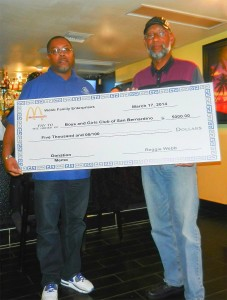Reggie Webb (right), Webb Family Enterprises, presents A. Majadi (left), President of the Boys & Girls Club of San Bernardino, with a check for $5000 for the program.