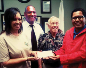 SafeCare Financial Services delivers on its pledge of $5000.00 and extends a challenge to other IE businesses to do the same. (L to R) Leilani Palmer, Excutive Director of YouthPower Solutions I E Youth Build Program; Wallace J. Allen, Host ETB; Reverend Jim Peterson, SafeCare Director; and Andrew Valles, SafeCare CEO and ETB Co-host.