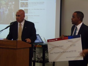 Joesph Williams being presented with a from Bank of America