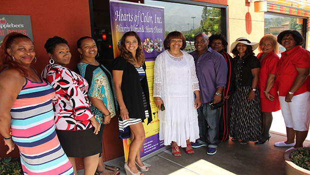 Joyce Fairman (wearing white, center) and Members, Hearts of Color, Inc, Board of Directors.