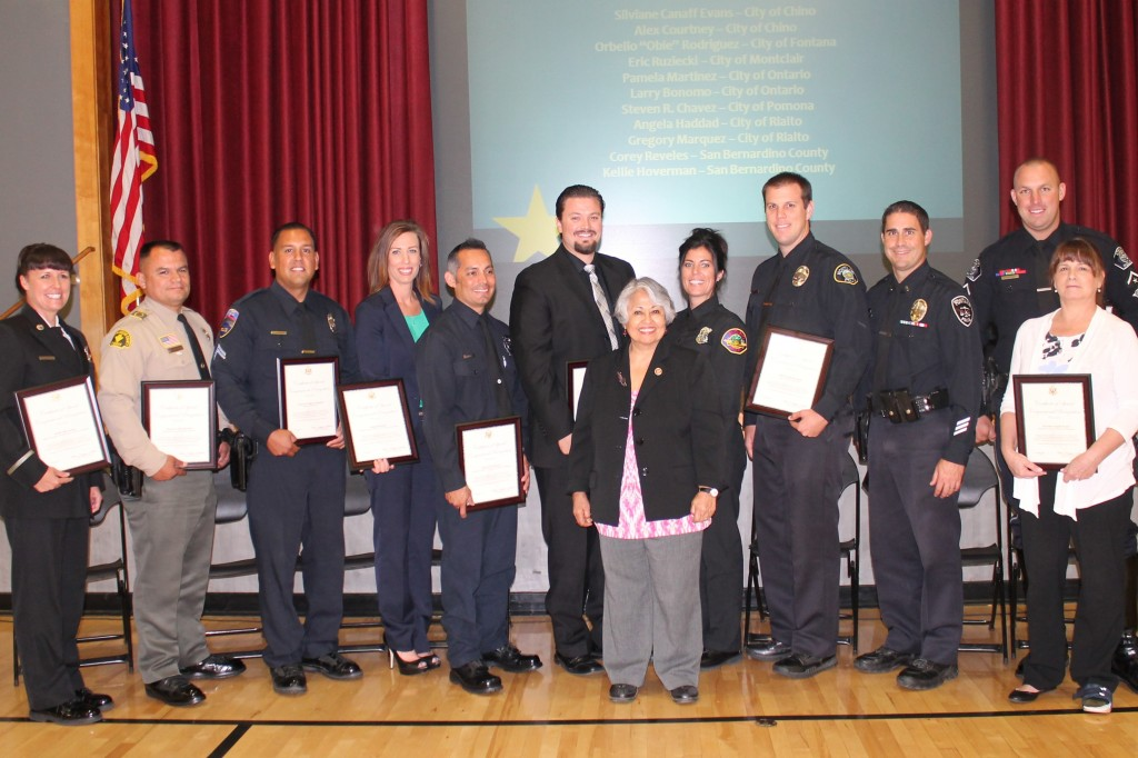 "Congresswoman Gloria Negrete McLeod with the 2014 35th Congressional District ""Public Safety Officer of the Year"" honorees."