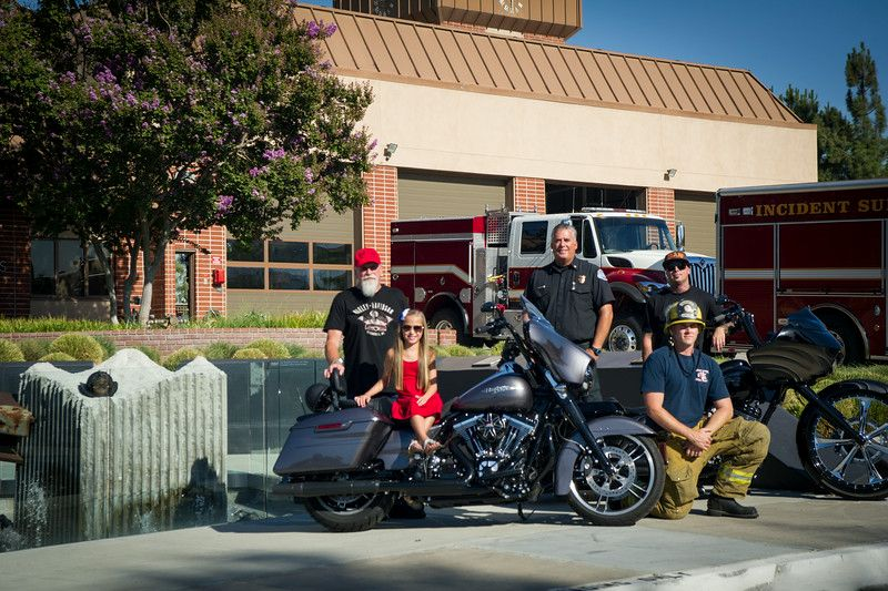 A 9/11 Memorial Ceremony and Ride is planned for Sunday, Sept. 7., to benefit Loma Linda University Children's Hospital and other worthy causes. In this photo are, front row, left to right: Carlie Mason, a patient at Loma Linda University Children's Hospital; Jake Feenstra, firefighter, Loma Linda Fire Department. Back row, left to right: Glenn Quaid, owner, Quaid Harley-Davidson; Don Benfield, battalion chief, Colton Fire Department; and Jimmy Todorovitch, of  Quaid Harley-Davidson