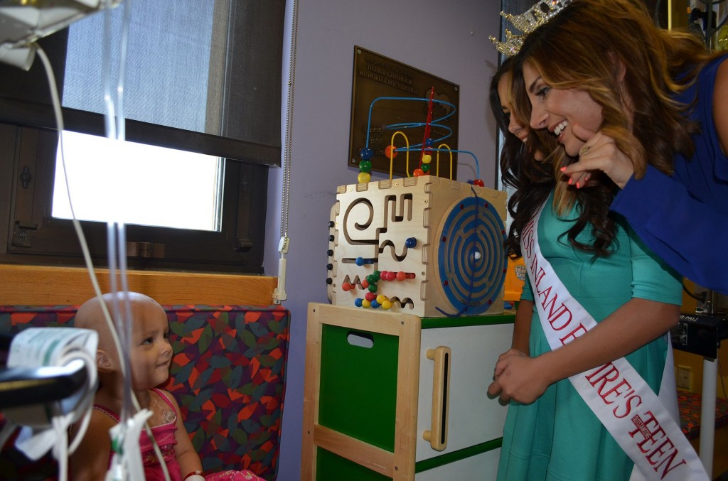 2014 Miss Inland Empire Rita Garabet, 21, of Redlands (right) and Miss Inland Empire Outstanding Teen Sophia Torres, 14, of Apple Valley, visit with Aubrey Olivas, 2, of Rancho Cucamonga, during the title holders' stop at Loma Linda University Children's Hospital on Wednesday, Sept. 10.