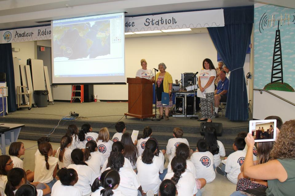 Congresswoman Gloria Negrete McLeod speaks with Dorothy Grant Elementary students as they contact the International Space Station using amateur radio.