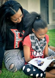 T'ana and daughter reading Bratty Tatty