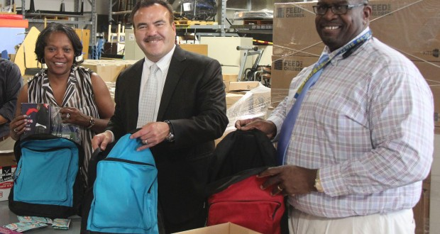 County Schools' Deputy Superintendent Ted Alejandre (left) puts supplies in backpacks, along with County Schools' Homeless Education specialist Brenda Dowdy (left) and Earl Smith, coordinator of Child, Welfare and Attendance for County Schools.