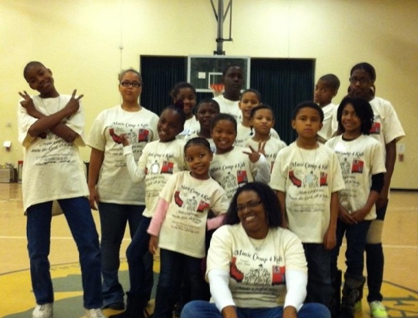 Choir Director, Ayanna Smith (front, center), poses with the Park Avenue Baptist Church A.M. Simpson and Youth Choir during the Children's Music Workshop in 2013.
