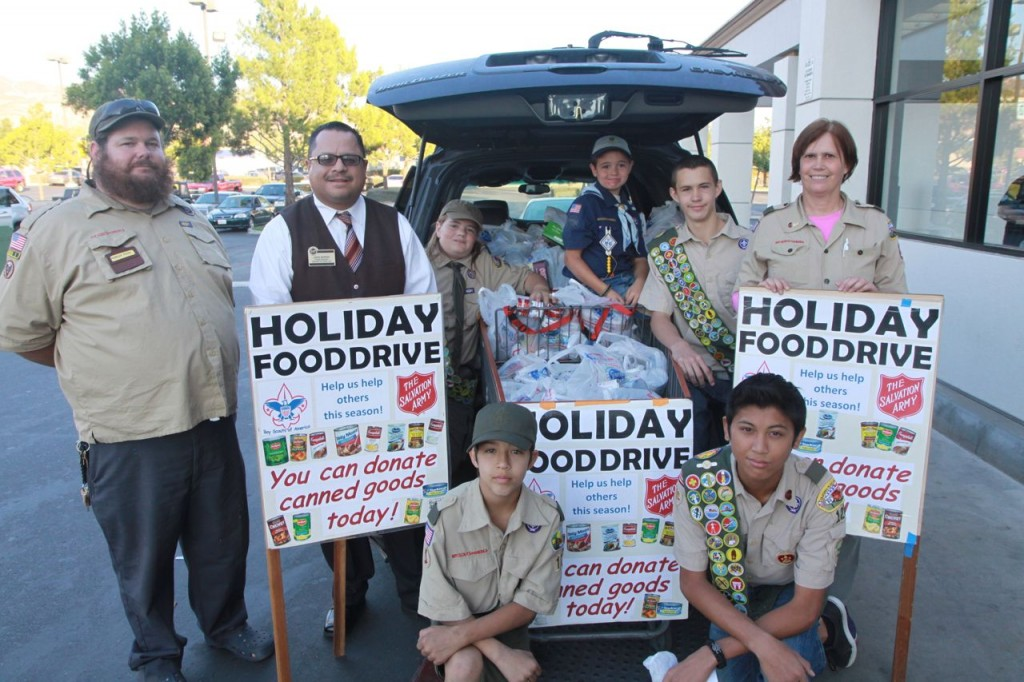 Back row left to right Scout Leader Charles Price, Stater Bros. Manager Jorge Moreno, Stone Price, Austin Price, Lucus Compagna, and Scout Leader Anne Compagna. Front left William Anderson, and front right Jason Bun.
