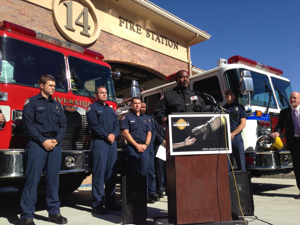 Riverside Fire Chief Michael Moore, flanked by firefighters from his city and Rancho Cucamonga at Riverside Fire Station 14, announces Riverside's participation in Supplying Aid to Victims of Emergency (SAVE), which provides immediate short-term relief to fire and disaster victims.