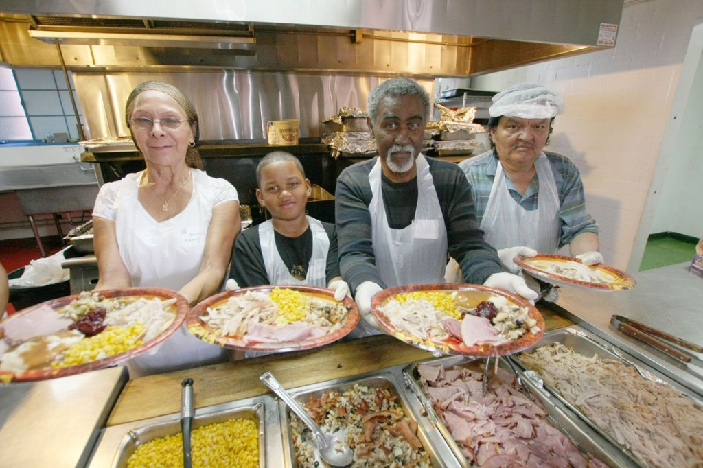 Volunteers serve Thanksgiving Dinner at The Salvation Army: Serving on the food line (left to right) is Nancy Veaegas, Niyahn Summey, Walt Summey, and Robert Sanchez. We are ready for Christmas Dinners.   (Photo by Ricardo Tomboc)