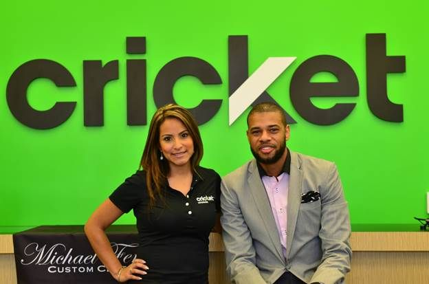 Michael Ferrera (right), founder of Michael Ferrera Custom Clothing and finalist in the Cricket Community Stars: Salute to Solopreneurs contest is pictured with Monica Cevallos, Cricket Wireless Senior Marketing Manager during an in-store celebration on Small Business Saturday. As a finalist, Ferrera is eligible to receive the grand prize package of up to $5,000 in cash and mobility prizes. Photo provided courtesy of Steed Media Group