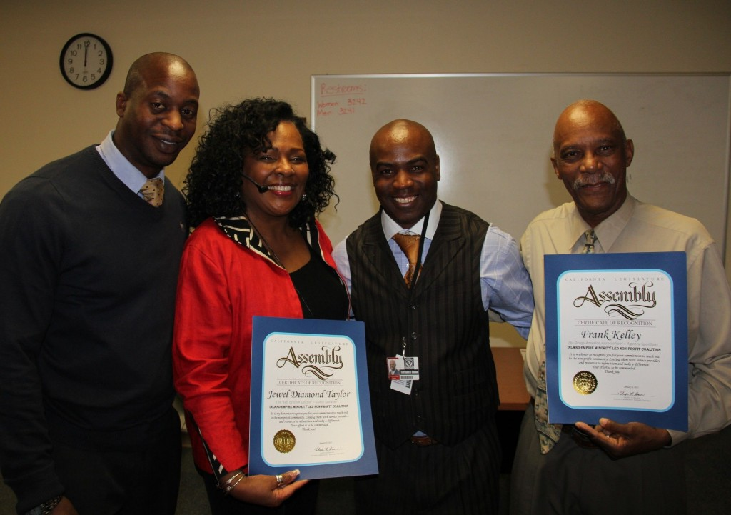 "Jonathan Buffong, Facilitator, IE NPRDC;   Jewel Diamond Taylor, (2nd from the left), & Frank Kelly, (3rd from the left), receive a ""Certificate of Commendaion"" from Assembly Member, Cheryl Brown;   & Terrance Stone, CoChair, IE NPRDC."