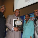 "Alton Garrett, (2nd from left)  received the ""Teamwork Award""  on behalf of the San Bernardino 'Westside Action Group', (WAG).  (from the left) City Councilman  Rikke Van Johnson;  Garrett:   Event Chair, Beverly Jones-Wright;   & Pastor, Phillip Powell, President, IECAAC."