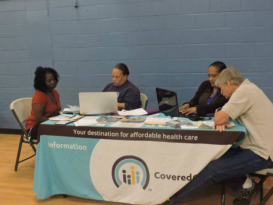 Community members signing up for affordable health care (Photo by Naomi K. Bonman).