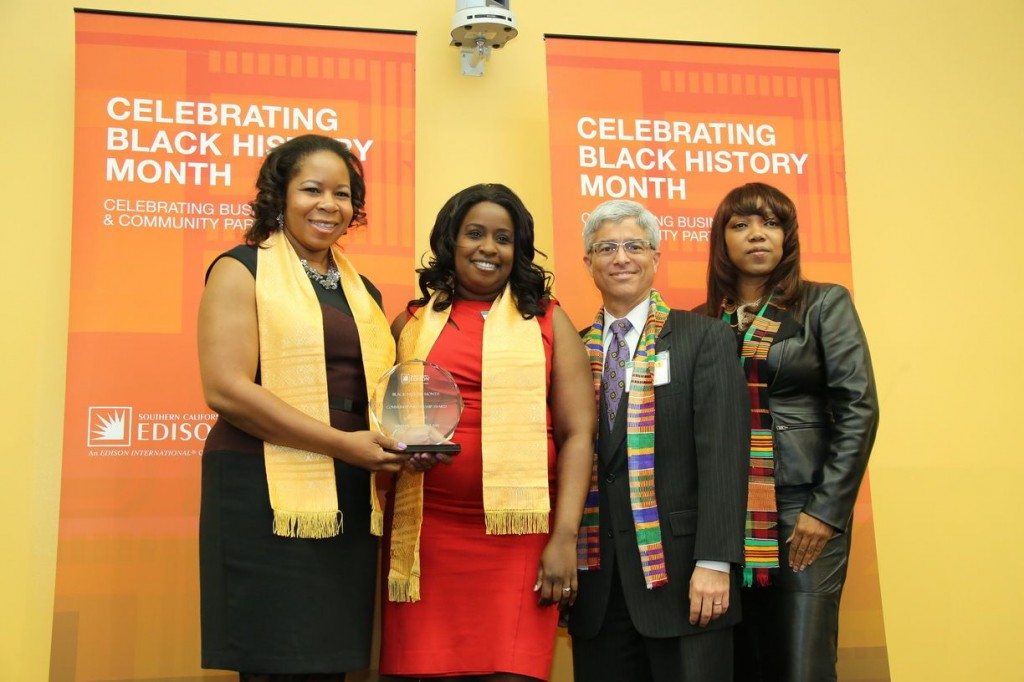 Tremaine Mitchell (second from left), director of Operations for the Youth Action Project, receives the Community Partnership Award from Southern California Edison (SCE) during SCE's recent Black History Month celebration.  SCE President Pedro Pizarro (second from right), Tammy Tumbling, director of Philanthropy and Community Involvement (right) and Qiana Charles (left), local public affairs manager, presented the award to the organization for successfully helping youth and young adults in the development of skills and habits needed to experience economic and social success. Since 2007, it has hired and trained more than 200 local college students, provided more than 90,000 work experience and community service hours and provided tutoring and mentoring to more than 1,000 high school students within the San Bernardino Unified School District.