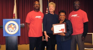 (L to R) Sam Appiah-Kubi (AARP staff), Nancy McPherson (AARP Interim State Pres.), Assemblymemer Brown, and Antoine Cook (AARP staff). Photo by Jon Gaede