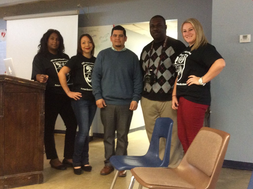 Social Work Policy group with Pal Charter guidance counselor Daniel Ibarra in middle