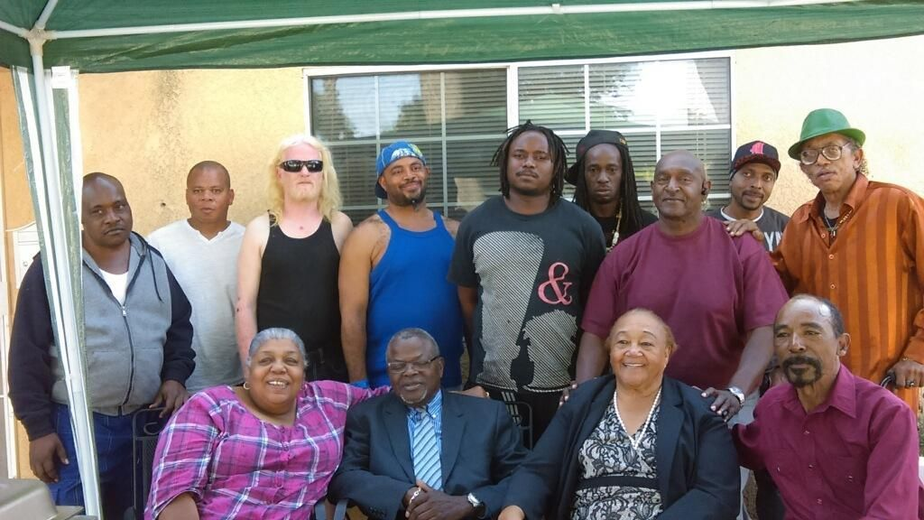 (First row) Dr. Deborah Winn, founder of WWAM; Allen Harris, Father of Watts; Sweet Alice Harris (Mother of Watts); and Aubrey Winn. (second row): Terry Boykins (white tee, second left) and Mama's Boys (M.O.M.).