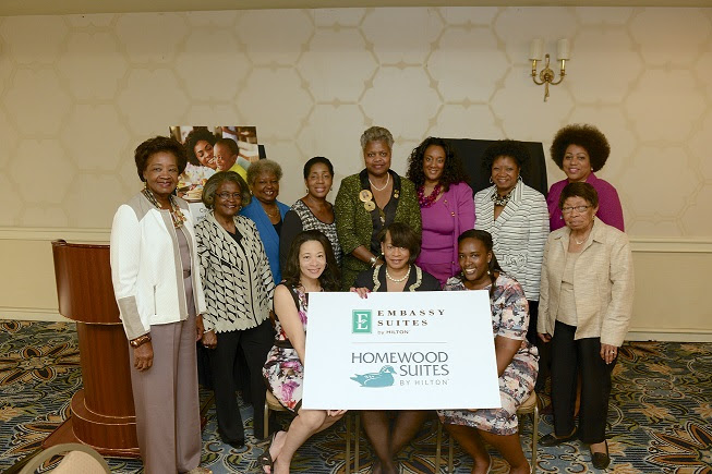 National Coalition of 100 Black Women, Inc., National President, Michele McNeill-Emery, (front center) during the breakfast hosted by Hilton Homewood/Embassy Suites during the organization's recent 17th Biennial Conference hosted at the Hilton Long Beach Hotel, Long Beach, California. Shown with her on the left is Hilton Worldwide director of resorts and multicultural marketing, Andrea Richardson. On her right, Lorraine Miller, Account Director, Burrell Communications. They are surrounded by members of the Coalition's national board of directors. (Photo Credit: CaughtInTheMoment.com)