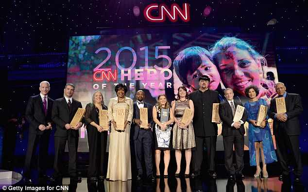 From left- Anderson Cooper and the 2015 Top 10 CNN Heroes