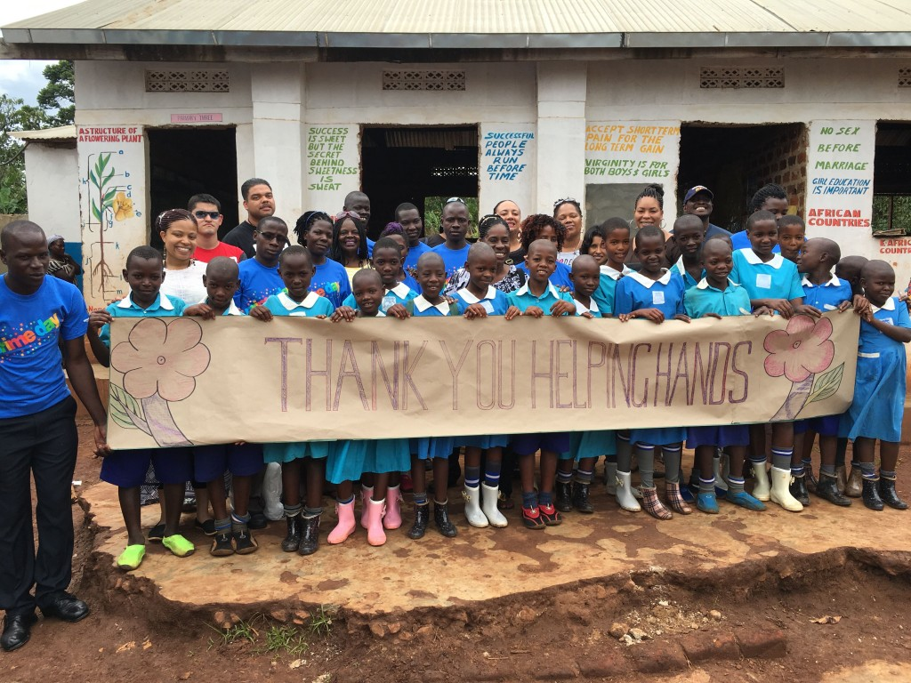 Students at New Generation Nursery and Primary School are all smiles after receiving shoes and school supplies donated from Helping Hands and the 1 Uganda Project.