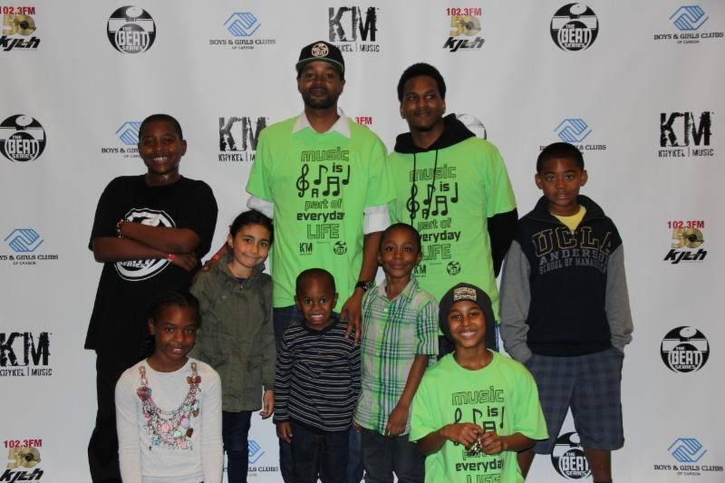 Torrey Adams with some of the attending children at the Music is a Part of Everyday Life Toy Drive, Tues., Dec. 22, 2015. (Photograph courtesy of Robert Byrd of BE-Radical Productions).