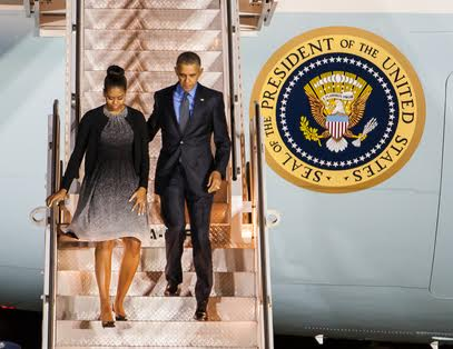Pres. Barack Obama and First Lady Michelle Obama step down from Air Force One after landing at the San Bernardino International Airport Friday night