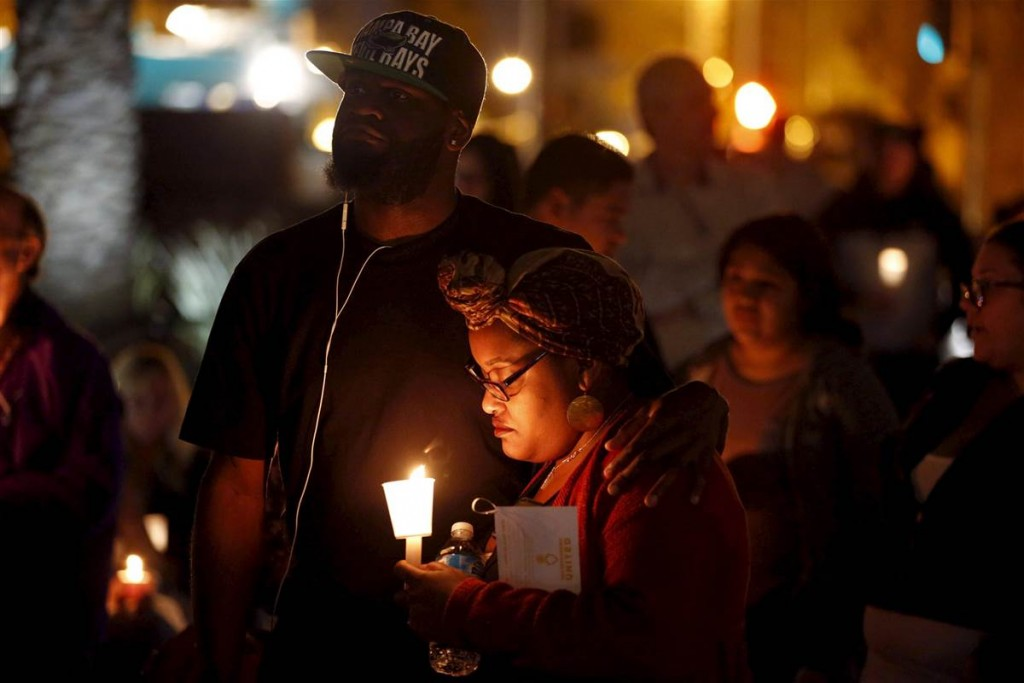 Community residents gather in San Bernardino during a previous candle light vigil for the victims of last Wednesday's attack. (Photo courtesy of NBC News).