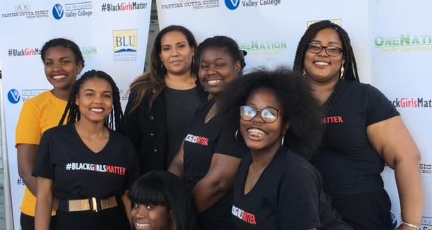 Panelist Zumar Zamaan (back center) pictured with students who work closely with Dina Walker