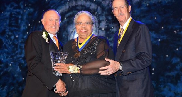 """Waudier """"Woodie"""" Rucker-Hughes accepts the Chamber's Citizen of the Year Award from Chairman Bob Stockton and past Citizen of the Year honoree Nick Goldware. Photo credit: Michael Elderman."""