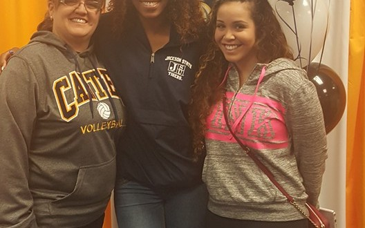 Taylor Jackson with her coaches, Coach Brody (left) and Coach Krystal (right).
