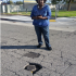 Harris, a member of the NWPAC, is using the GORequest app to report a pot hole
