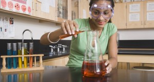 Teenage girl performing science experiment
