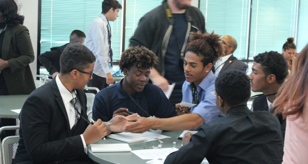 Students at the Youth Poverty Symposium discuss their roles and responsibilities as advocates to their fellow students.