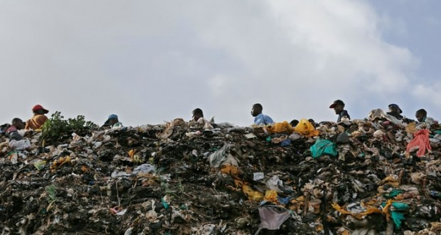 Plastic bags stick out of a pile of rubbish in the Kibera slum in Nairobi, Kenya. Photograph: Daniel Irungu/EPA
