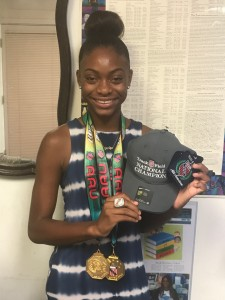 Jordyn Grady displaying her medals and ring that she won in the AAU Junior National Olympics. (Photo Credit: Naomi K. Bonman)
