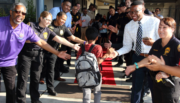 Community members greet Hunt Elementary School students on the first day of school in August 2016.
