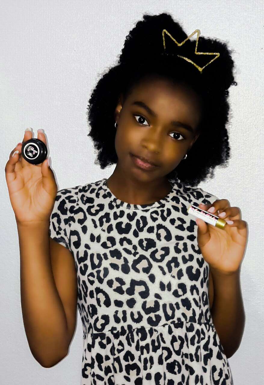 Tanai Smithholding up her Crown Me Lip Balm. (Photo Credit: Tana Phelice)