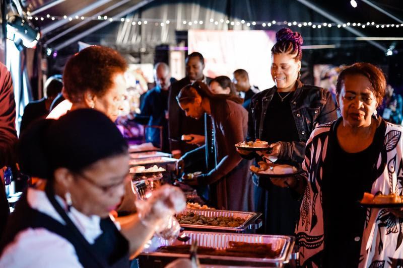 Attendees enjoying a hearty brunch. Photo Credit: Koi Sojer, Snap'N U Photos