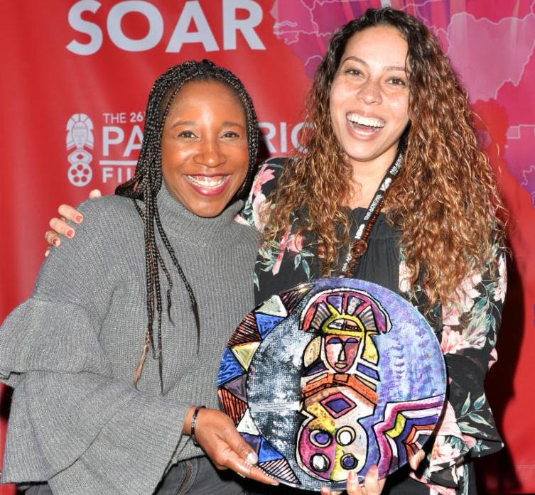 "Lalo's House Executive Director, Lisa Wilson and Director, Kelley Kali, accept ""Programmers' Award - Narrative or Documentary Short.""  Photo Credit: Koi Sojer, Snap'N U Photos"