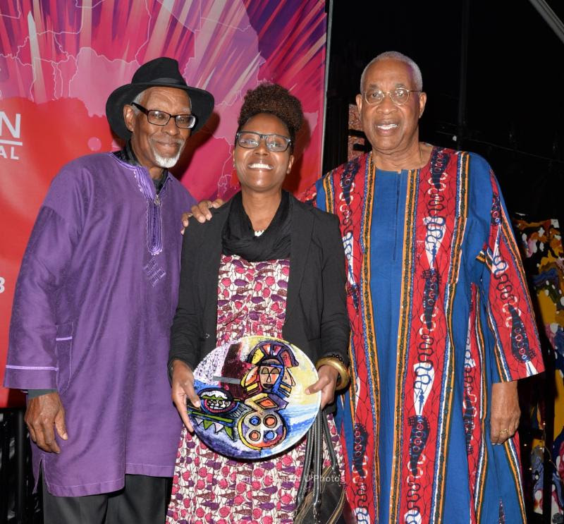 "Director Aminah Bakeer Abdul-Jabbaar accepts the ""Audience Award - Narrative Feature"" for ""Muslimah's Guide to Marriage"". Standing with her is her father, author/filmmaker, Donald Bakeer, and Ayuko Babu. (Photo Credit: Koi Sojer/Snap'N U Photos)"