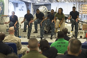 170223-N-LI768-363 GULF OF ADEN (Feb. 23, 2017) Sailors and a Marine perform a step dance during the African American and Black History Month celebration aboard the amphibious assault ship USS Makin Island (LHD 8).  The ship is deployed in the U.S. 5th Fleet area of operations in support of maritime security operations designed to reassure allies and partners, and preserve the freedom of navigation and the free flow of commerce in the region. (U.S. Navy photo by Mass Communication Specialist 3rd Class Devin M. Langer)
