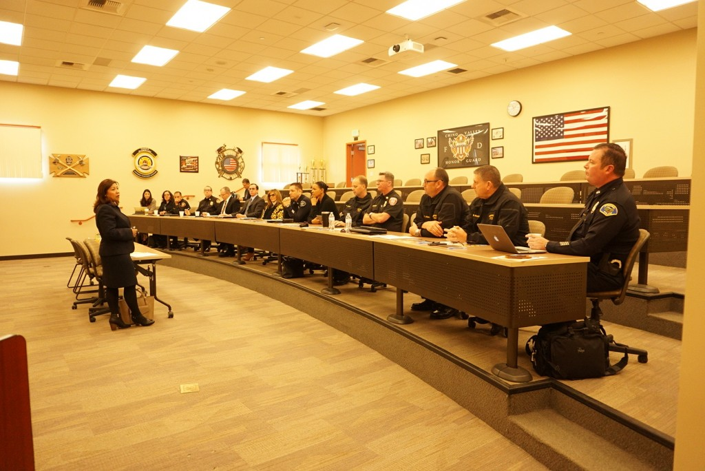 U.S. Representative Norma J. Torres speaks with fire and police chiefs in Chino.