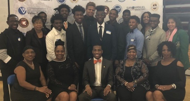 Former Knight Arlington Rodgers III (Center) Junior at Morehouse with Social Lites Beautillion Committee Members (Donna Little-John, Chair) and Knights